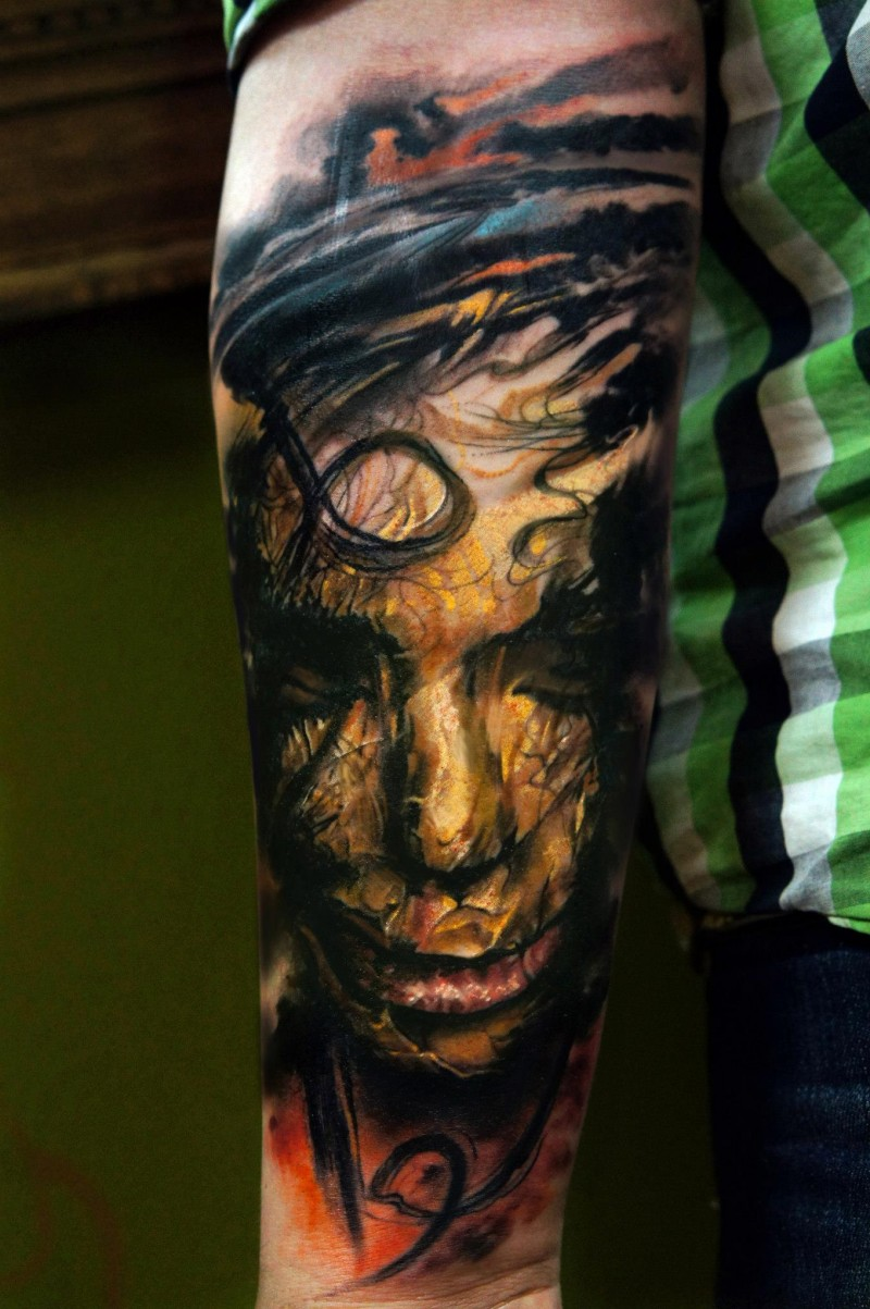 Image style colored arm tattoo of creepy mummy face