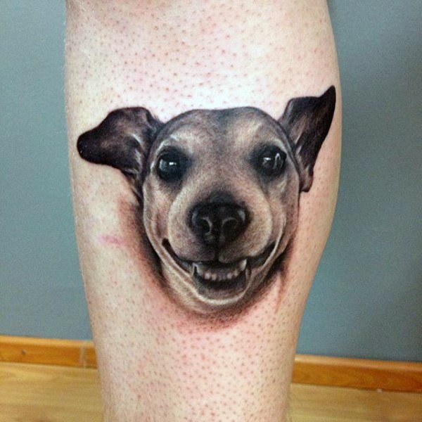 Impressive 3D like funny dog portrait tattoo on leg