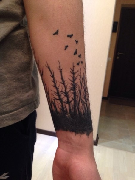 Impressive and mystical black ink old forest with flowers tattoo on wrist