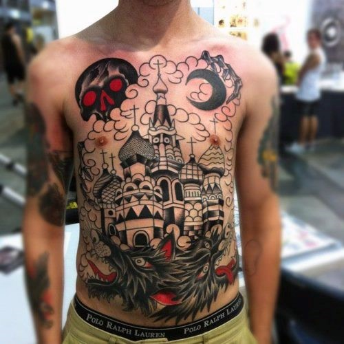 Impressive and mystical castle with skull and dogs tattoo on chest and belly