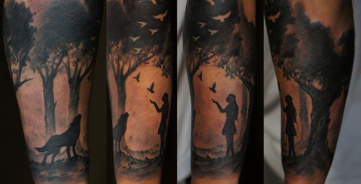 Impressive black and white forearm tattoo of girl in forest with wolf and birds