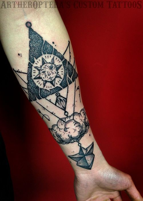 Impressive black and white puzzle like mystical tattoo on arm