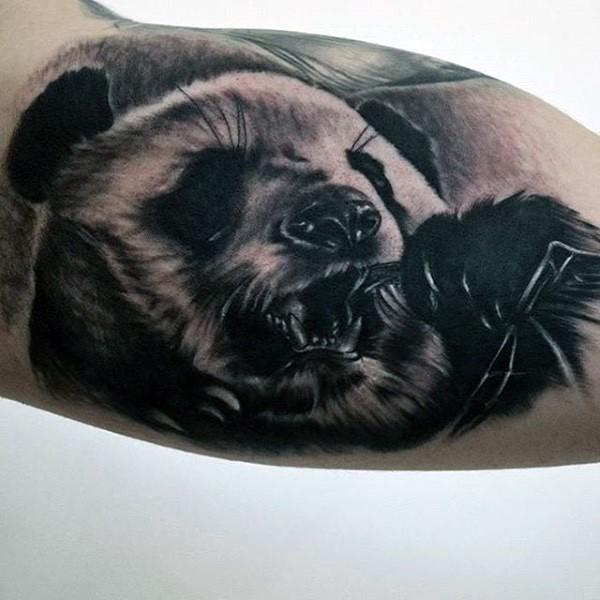 Impressive colored biceps tattoo of big and cute panda bear