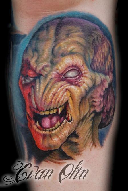 Impressive colored horror style forearm tattoo of alien face