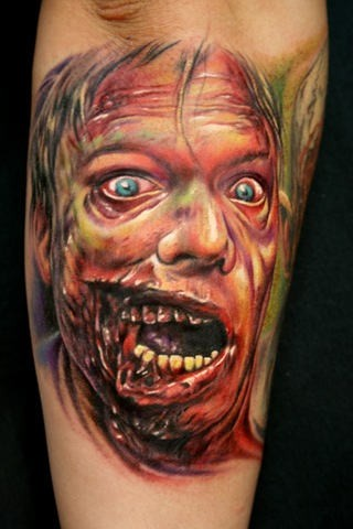 Impressive detailed and colored forearm tattoo of zombie face tattoo