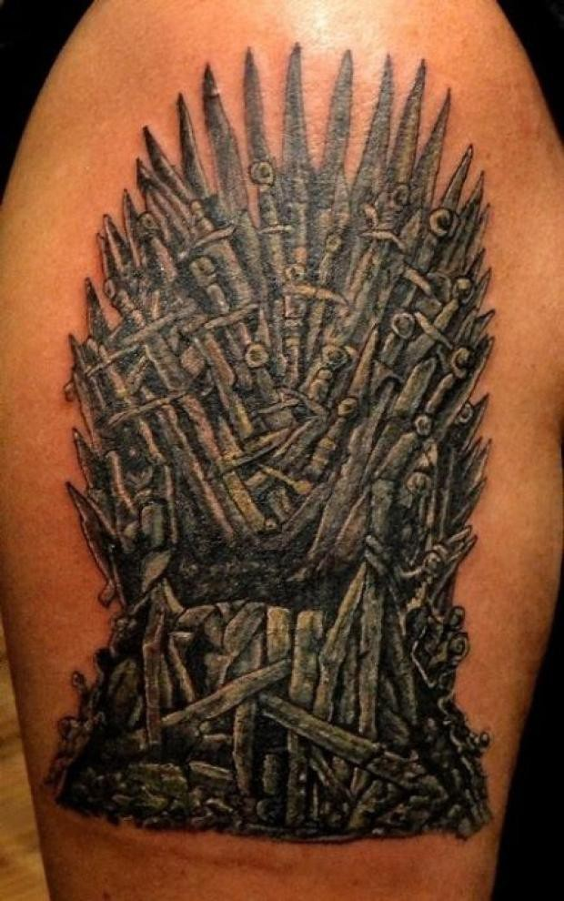Impressive detailed massive colored shoulder tattoo of Game of Thrones TV-serials throne