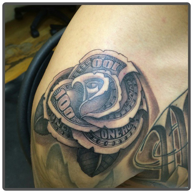 Impressive flower shaped money bill tattoo on shoulder