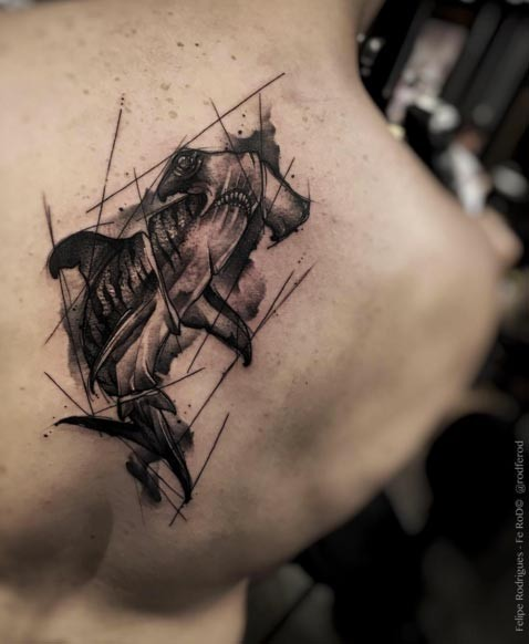 Impressive looking black ink sampled tattoo on back of hammerhead shark