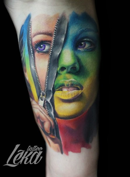 Impressive looking colored arm tattoo woman face with zipper