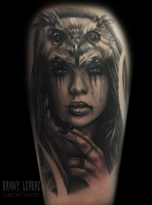 Impressive looking colored tattoo of woman face with owl