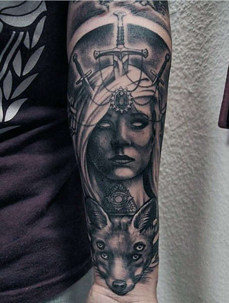 Impressive mystical designed black and white woman with swords and creepy fox tattoo on arm
