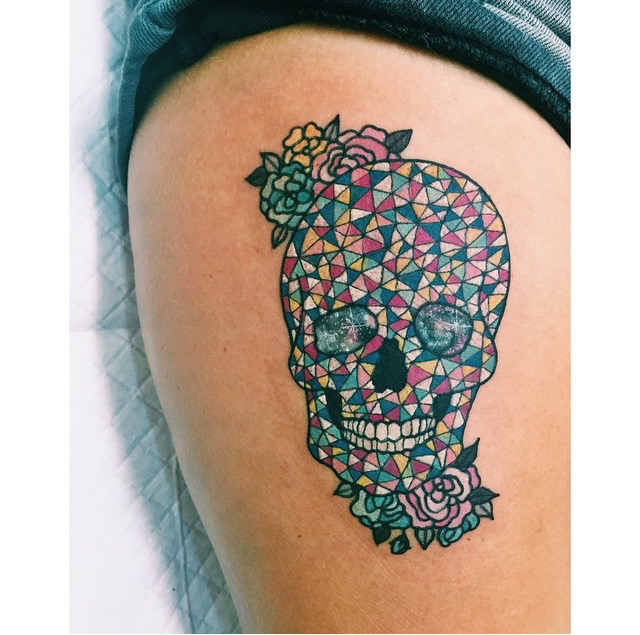 Impressive ornamental style colored thigh tattoo of cool skull with flowers