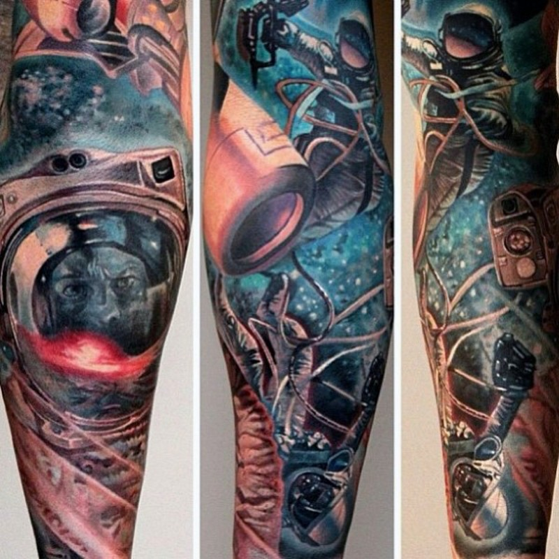 Impressive painted and colored space themed tattoo on sleeve