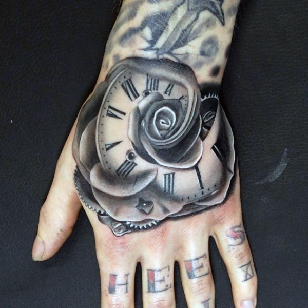 IMpressive painted black and white flower shaped mechanic clock tattoo on hand