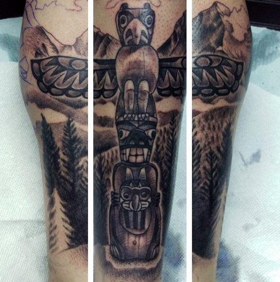 Impressive painted colored tribal statue tattoo onleg