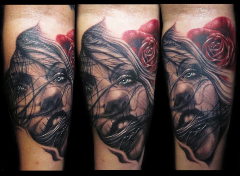 Impressive painted realistic looking woman face tattoo on forearm with red rose