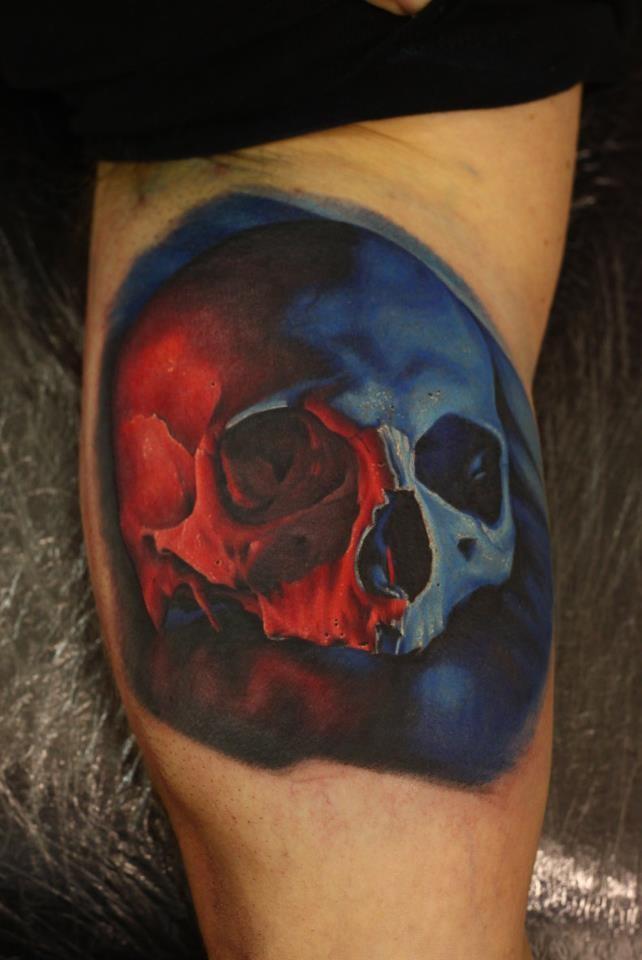 Impressive realistic looking very detailed skull tattoo on arm