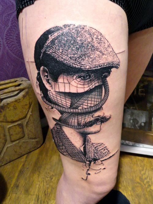 Impressive style painted unusual man face portrait tattoo on thigh