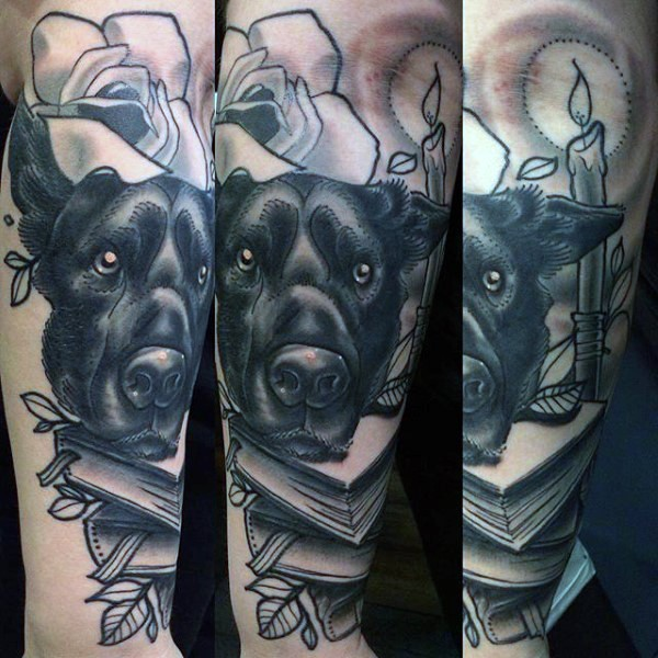 Impressive very detailed black ink dog with books tattoo on arm