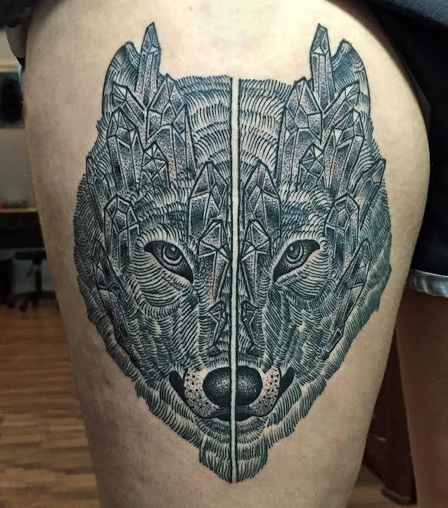 Impressive very detailed thigh tattoo of stone like wolf
