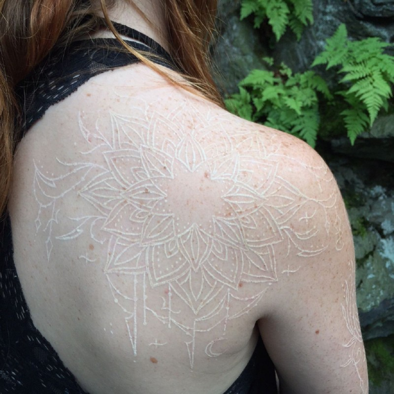 Impressive white ink painted massive shoulder tattoo of flowers