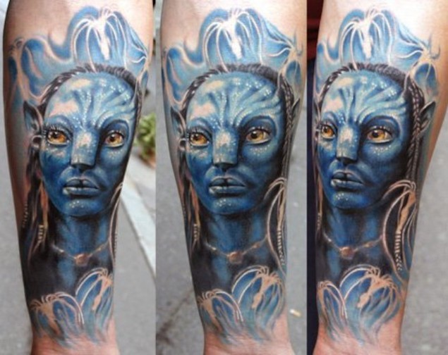 Incredible 3D style colored forearm tattoo of Avatar hero
