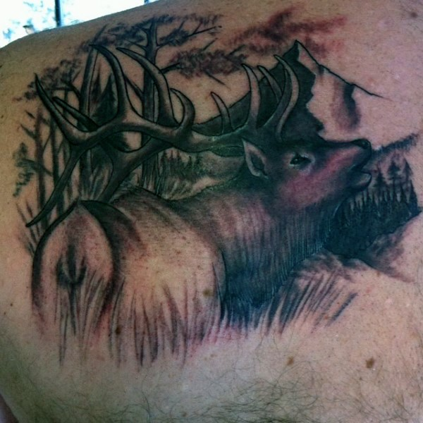 Incredible black and white shoulder tattoo of detailed deer in forest