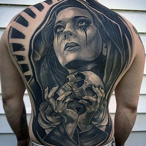Incredible black and white whole back tattoo of mystic woman with skull and rose