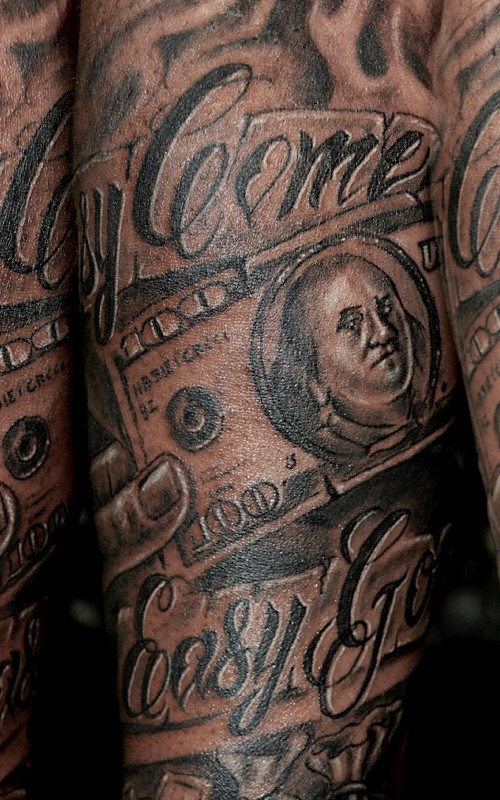 Incredible black ink forearm tattoo on money bill with lettering