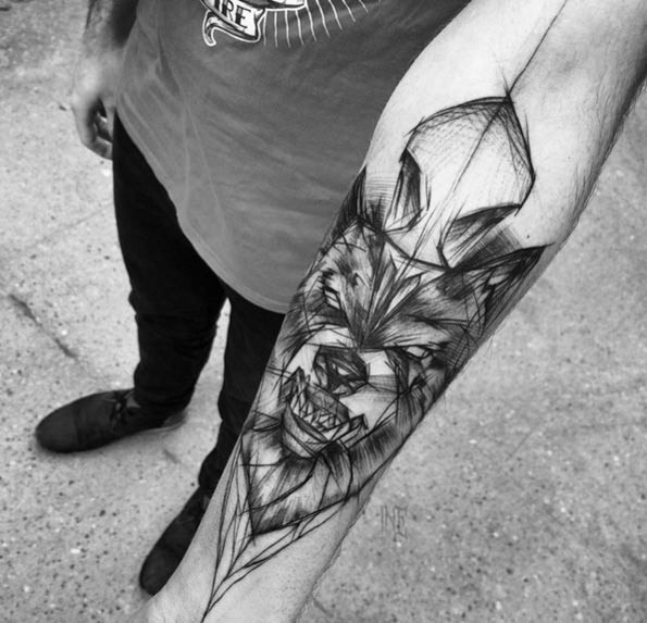 Incredible black ink homemade like forearm tattoo of evil wolf face