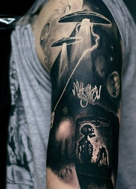 Incredible colored shoulder tattoo of alien ships with human skeleton and lettering