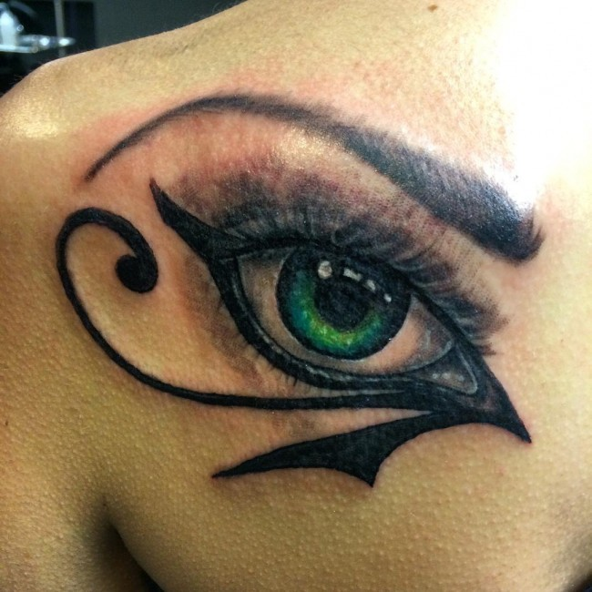 Incredible design green eye Egyptian special symbol the Eye of Horus tattoo on shoulder blade