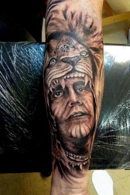 Incredible designed American native old Indian portrait tattoo on forearm with helmet from lion skin