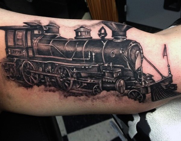Incredible detailed black and white old train tattoo on arm