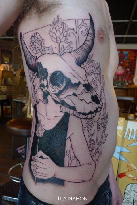 Incredible looking black ink large side tattoo of human with flowers and deers skull
