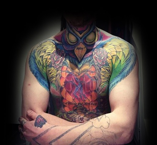 Incredible looking colored chest and shoulder tattoo of mystical bird and flowers