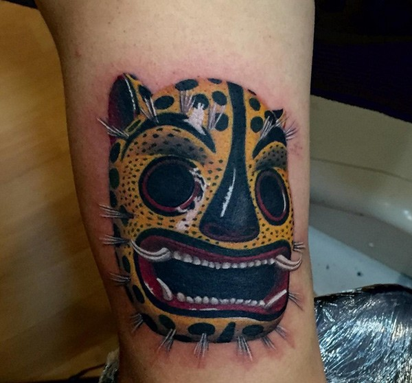 Incredible looking colored japanese mask tattoo on arm