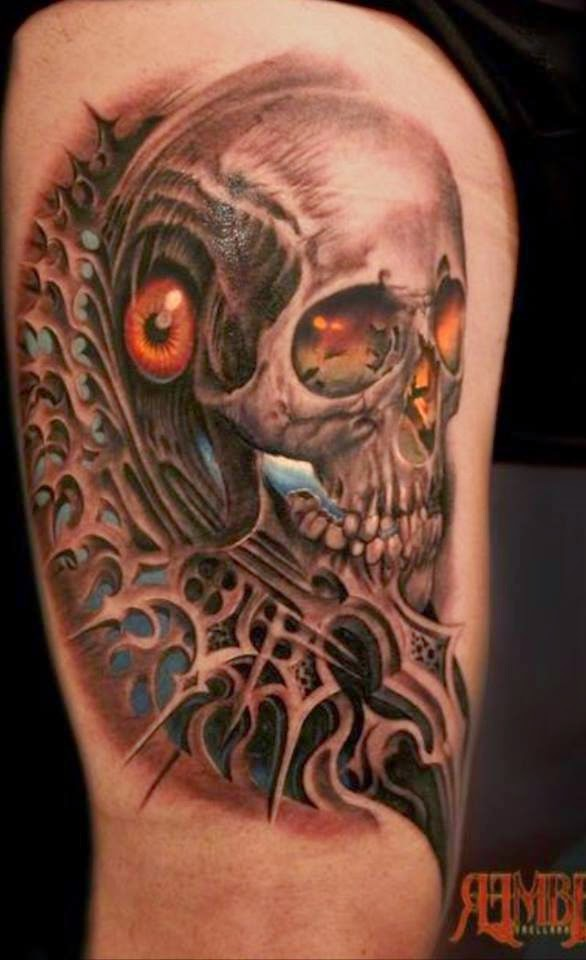 Incredible looking colored thigh tattoo of fantasy skull with creepy eye