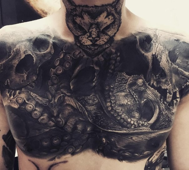 Incredible looking very detailed chest tattoo of big octopus with cat head and skull