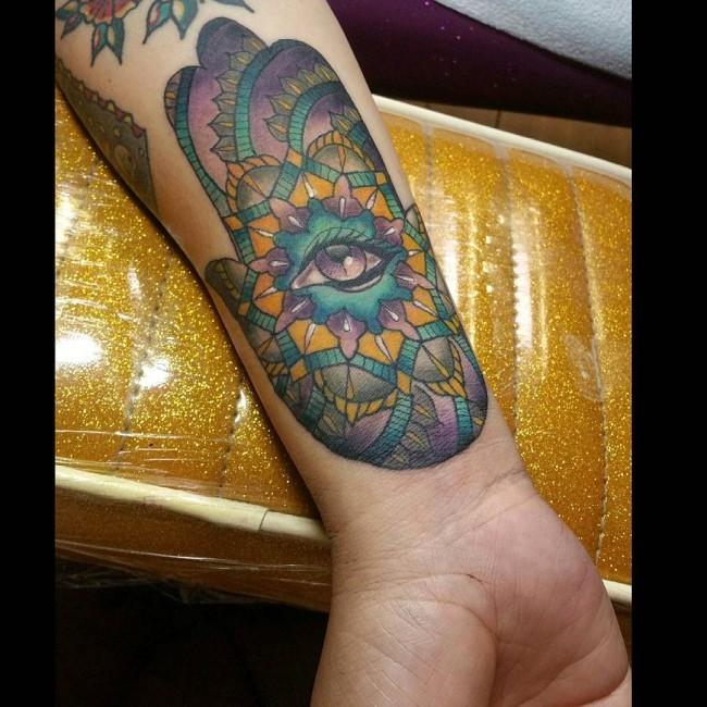 Incredible multicolored mystic Hamsa hand tattoo on forearm