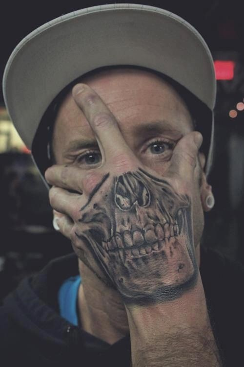 Incredible natural looking black and white hand tattoo of skull part