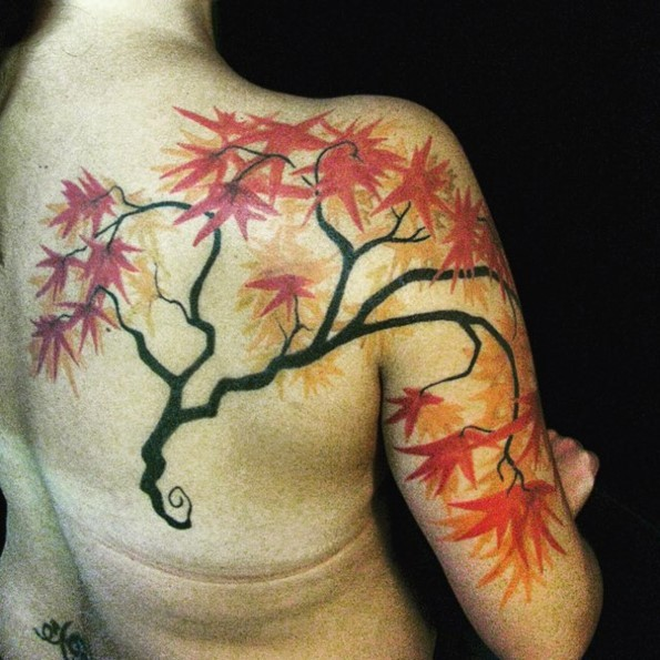 Incredible natural looking little mystic tree with big leafs tattoo on shoulder and back