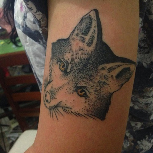 Incredible old school style colored fox tattoo on arm with yellow eyes