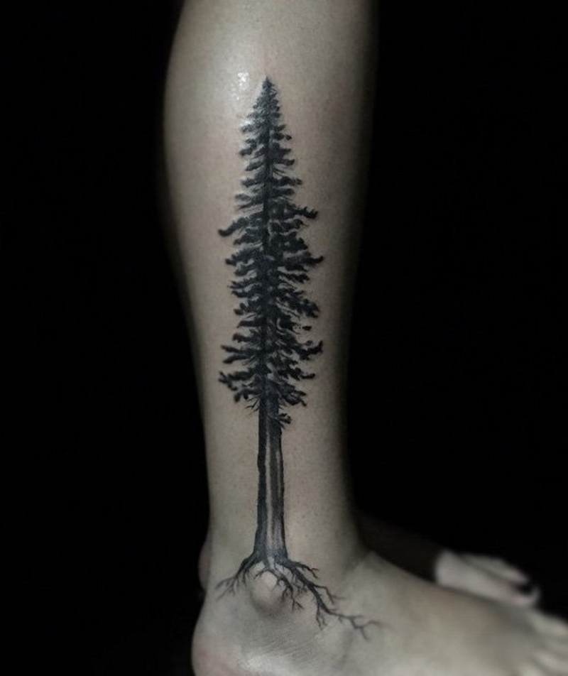 Incredible painted big black ink lonely tree tattoo on ankle