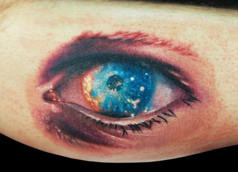 Incredible painted little multicolored eye tattoo on leg