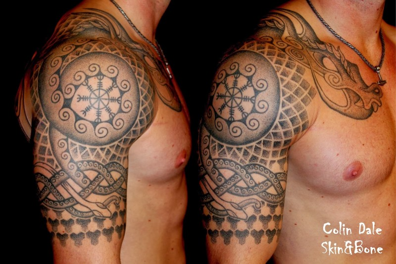 Incredible tribal paintings like detailed shoulder tattoo with snakes