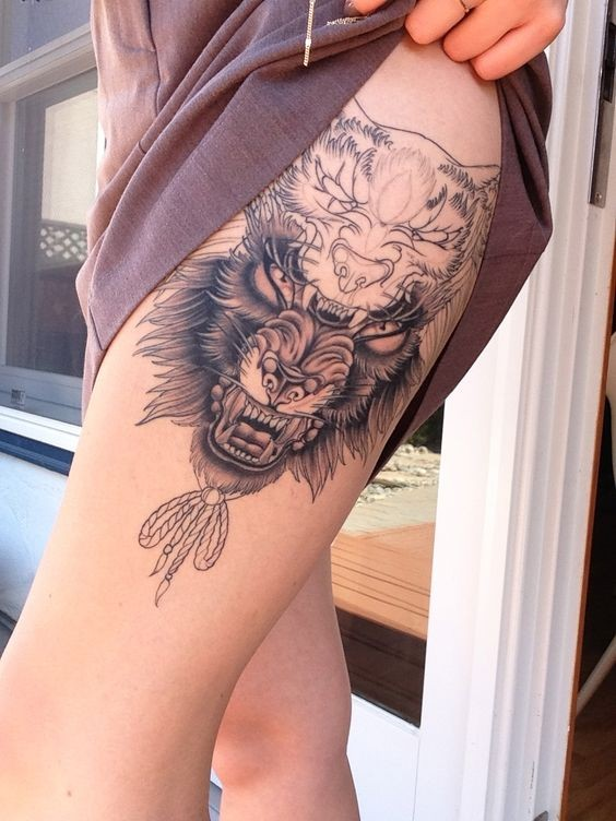 Incredible unfinished black ink thigh tattoo of various beasts