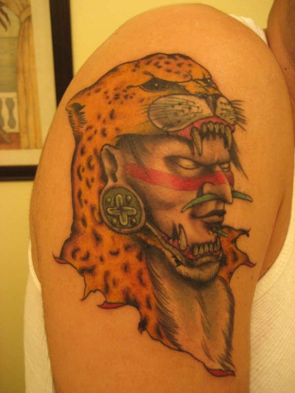 Indian warrior in a helmet from head leopard tattoo