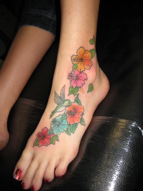 Ink colibri painted on girls foot