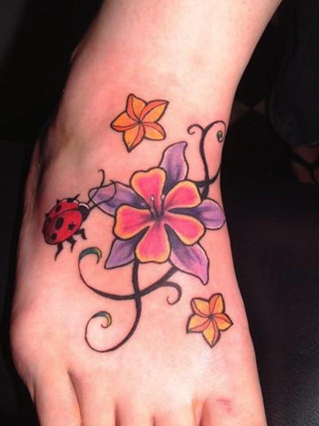 Pink ladybug flowers cute foot tattoo